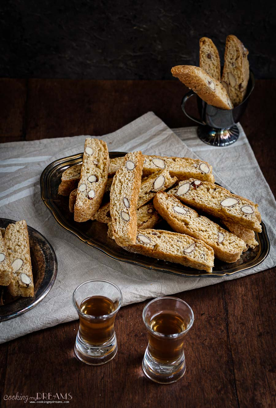 tray of cantucci with 2 shots of vin santo