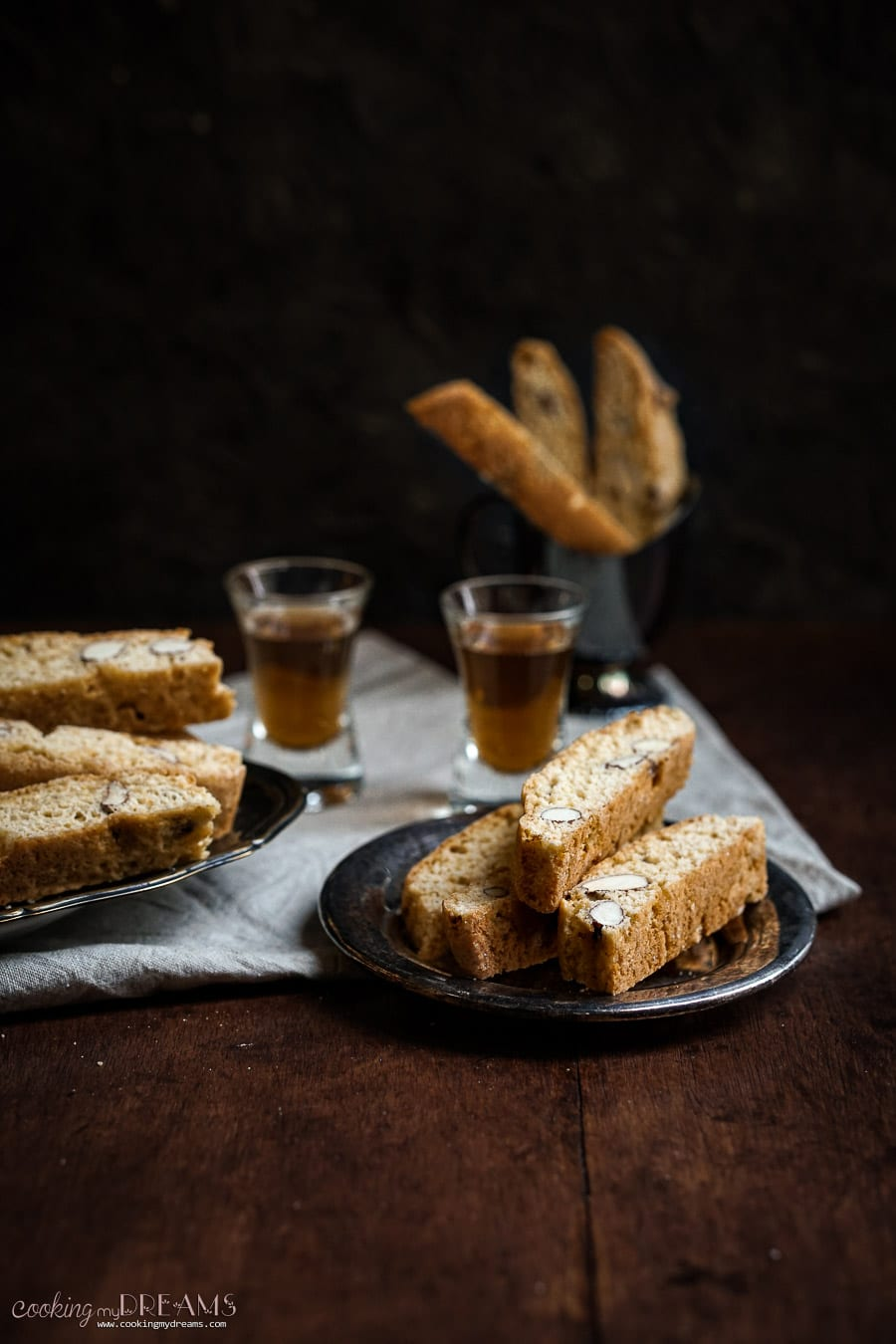 small tray with 3 biscotti and 2 shots of vin santo