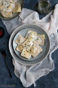 overhead plate with salmon ravioli in cream sauce