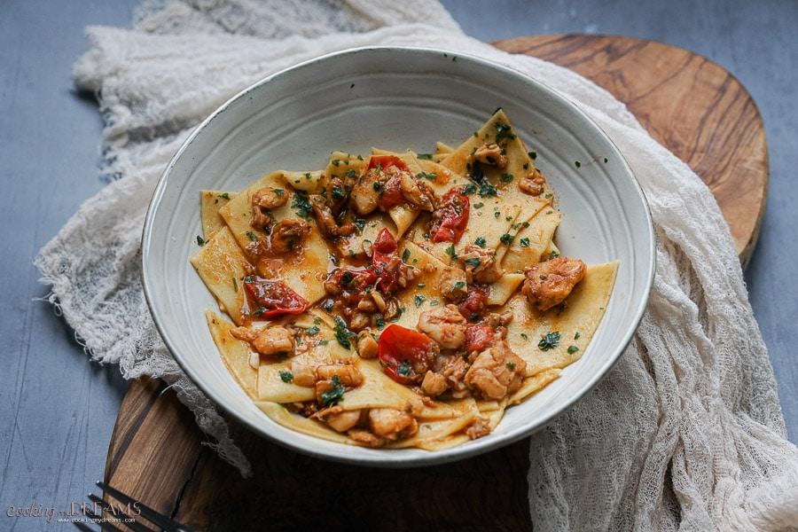 bowl of maltagliati with cod and tomatoes