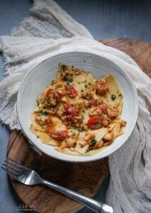 bowl of pasta with fish and tomatoes