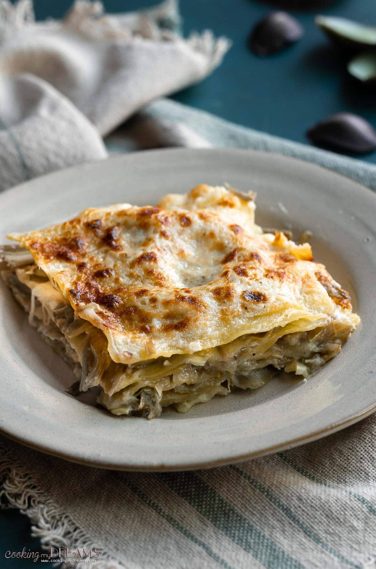 portion of artichoke lasagna on a plate