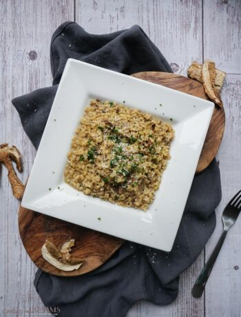 white square plate with mushroom bulgur risotto