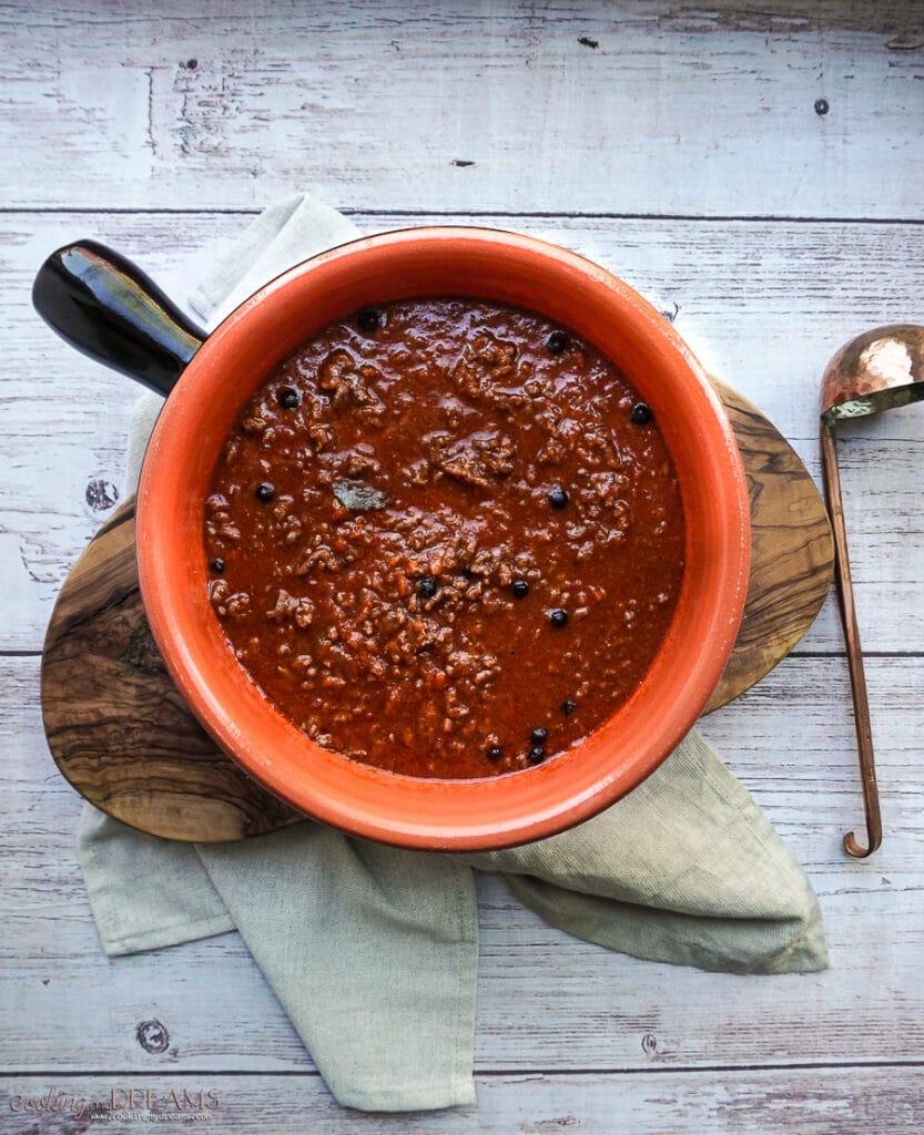overhead terracotta pot with ragu sauce