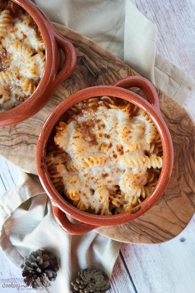 Terracotta bowls with Pasta al forno, Italian pasta bake