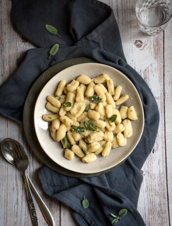 overhead plate of potato gnocchi with butter and sage