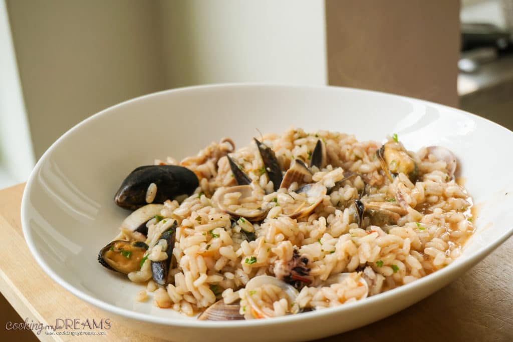 white plate with seafood risotto