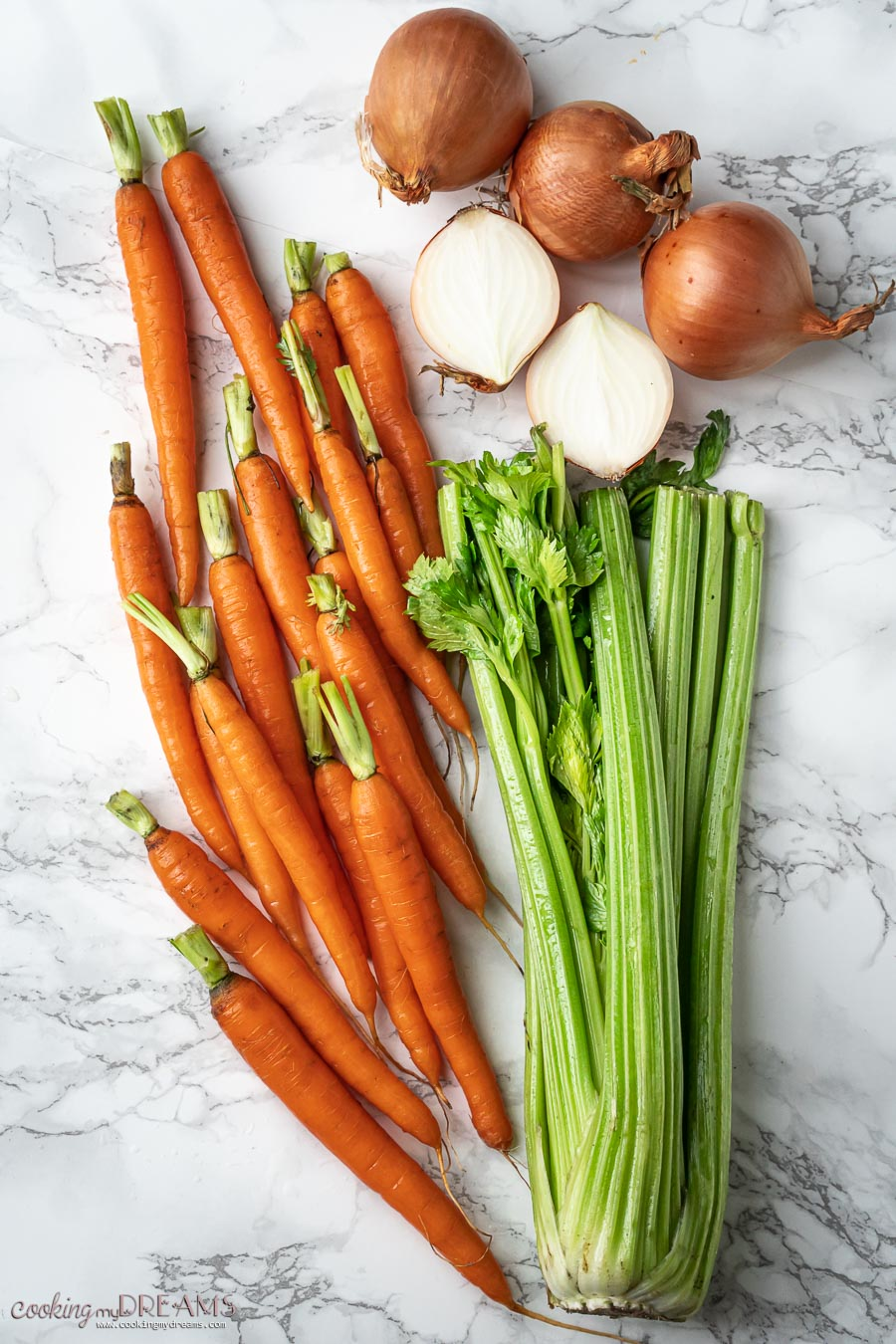 carrots, celery and onions on a board