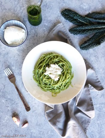 overhead shot with spaghetti with cavolo nero pesto and burrata