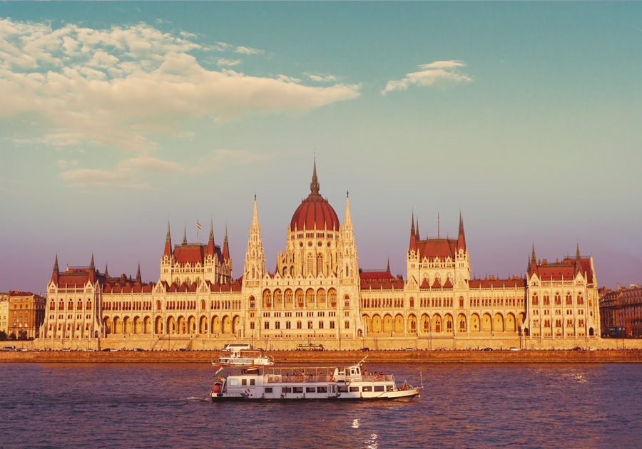 sunset photo of Budapest parliament with golden colors