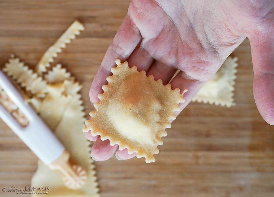 Hand holding a raw ravioli