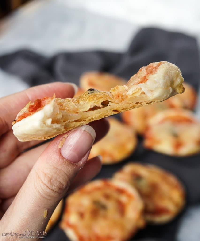 close up bite shot of puff pastry pizza