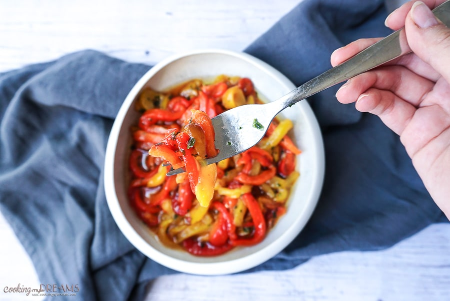 marinated roasted bell peppers on a fork