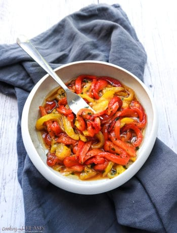 marinated roasted bell peppers in a white bowl