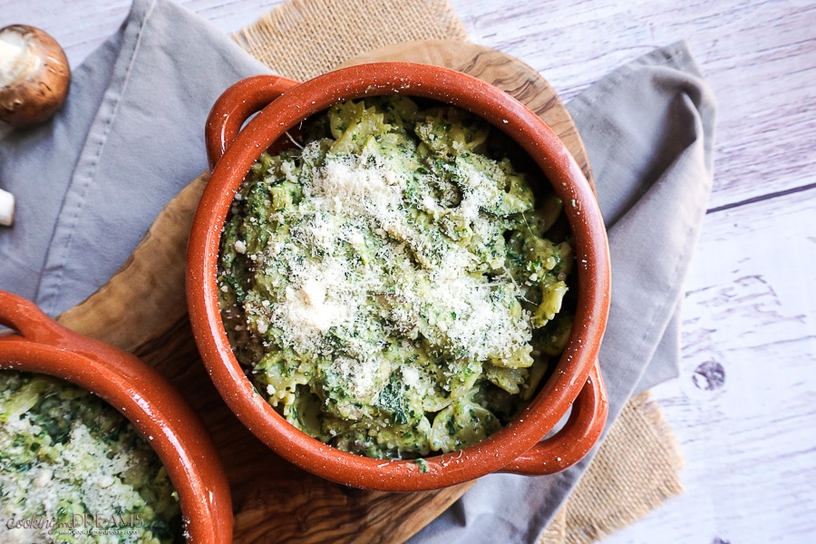 terracotta cocotte with pesto pasta bake and parmesan