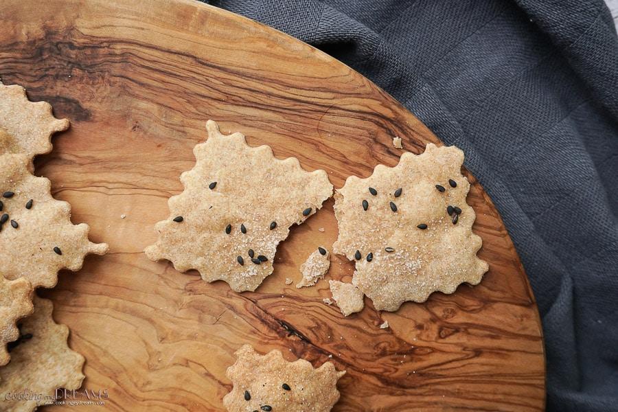 close up of a broken up spelt craker with sesame seeds
