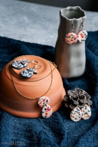 polymer clay terrazzo earring and necklace on display