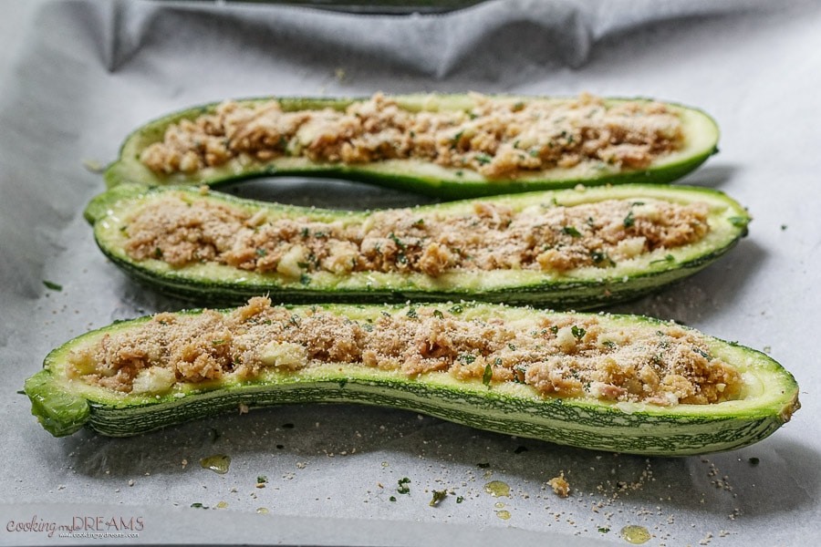 zucchini boats on a baking sheet before going in the oven