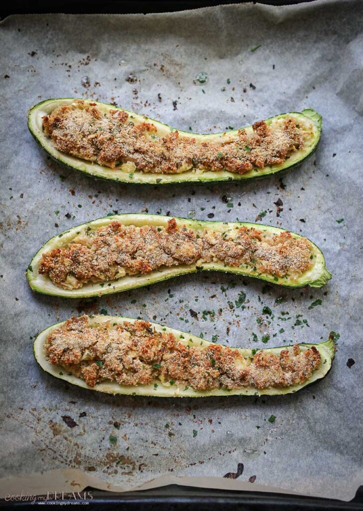 overhead photo of 3 baked zucchini boats
