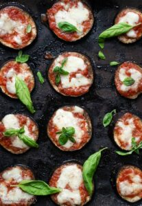 cooked eggplant pizzas on a baking tray