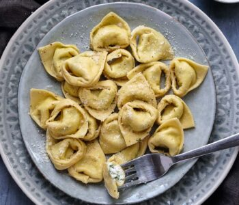 plate of tortelli with fork holding half