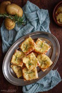 rosemary potato tarts on a serving tray