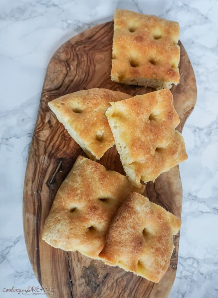 squares of focaccia on a wooden board