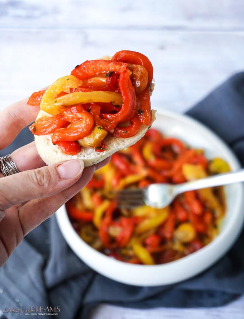 marinated roasted bell peppers on a slice of bread