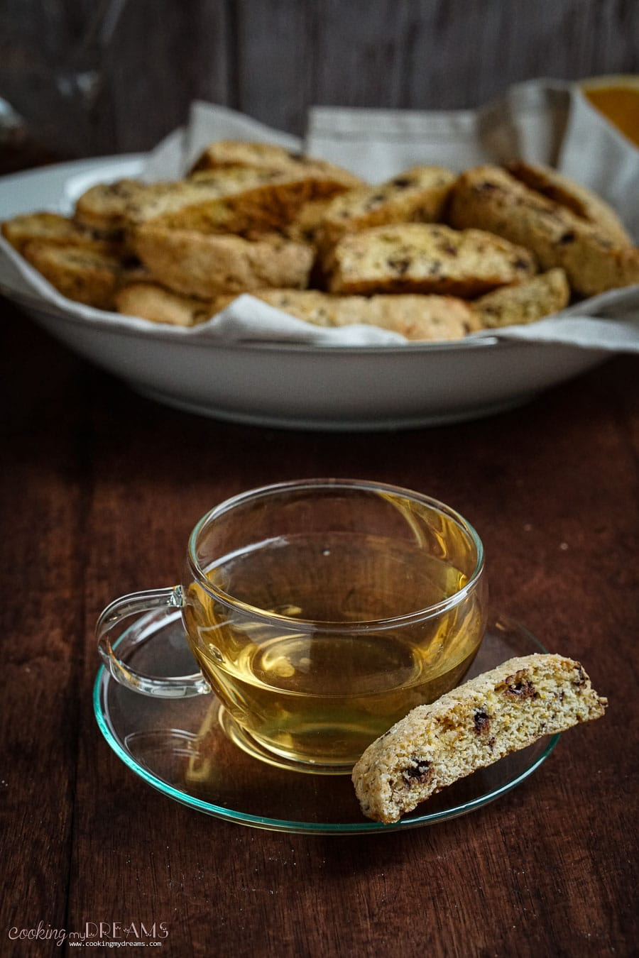 glass cup of tea with a biscotti