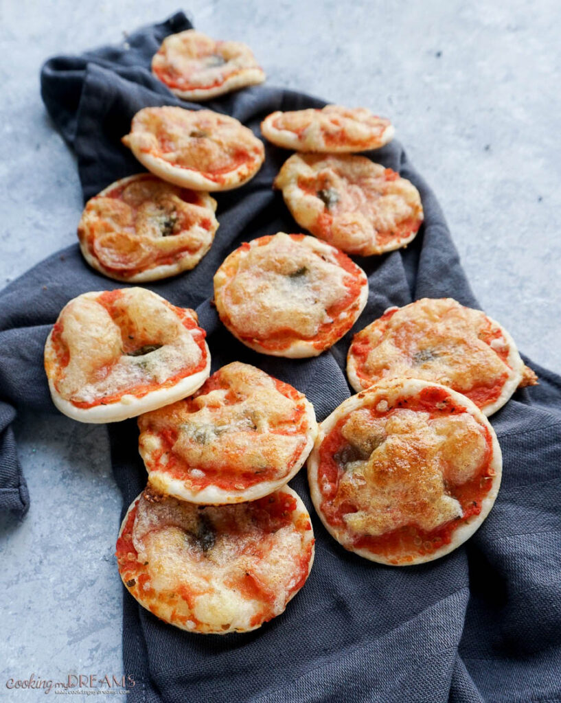 puff pastry mini pizza on a towel