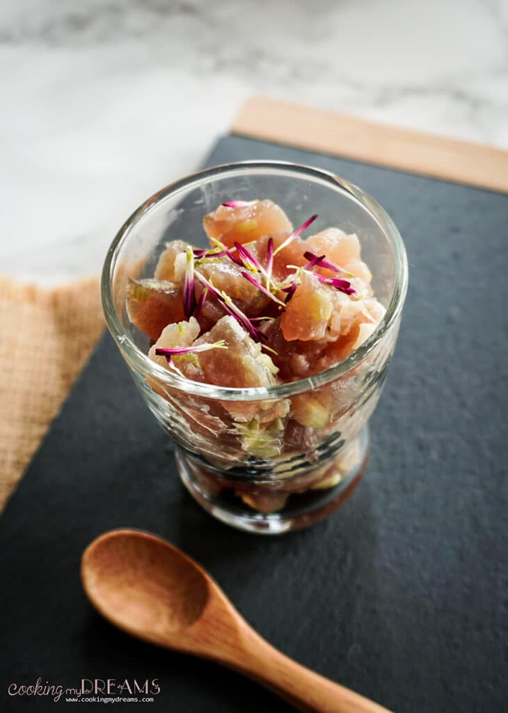 tuna tartare in a small glass with a wooden spoon