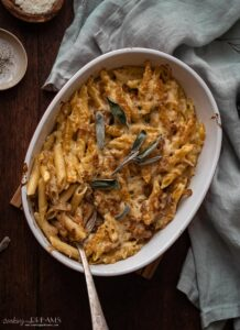 overhead dish with baked caramelized onion pasta bake with a spoon