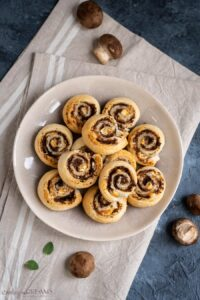 overhead of puff pastry pinwheels on a brown plate