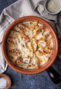 overhead baking dish with gratin mushroom ham pasta bake