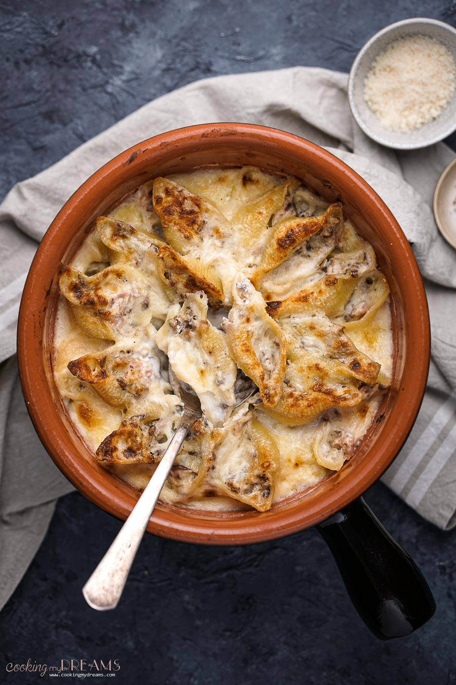 overhead baking dish with gratin mushroom ham pasta bake with a spoon
