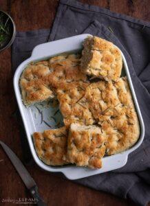 overhead of potato rosemary focaccia bread in the pan