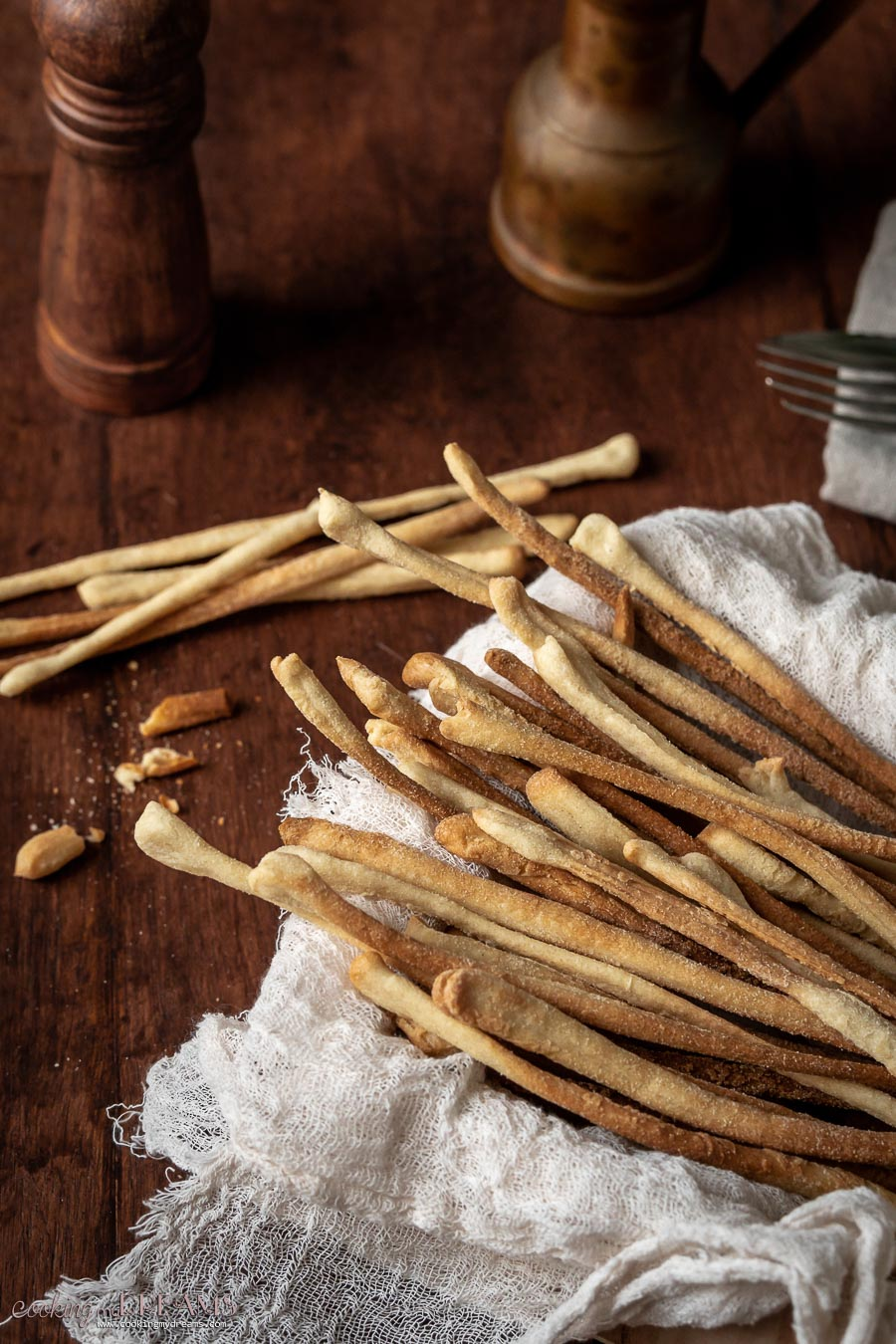 grissini breadsticks in a basket and on the table