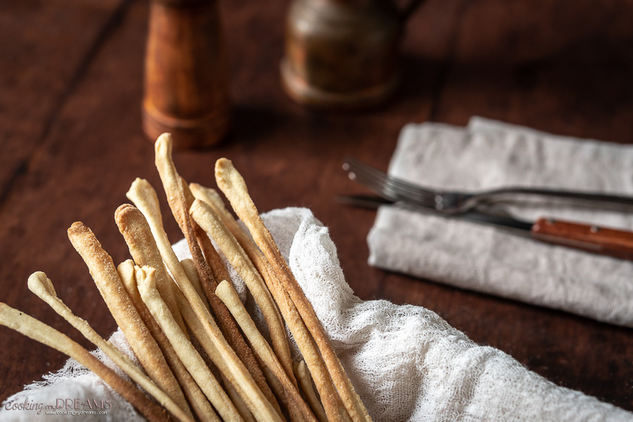 close up of grissini breadsticks in a basket
