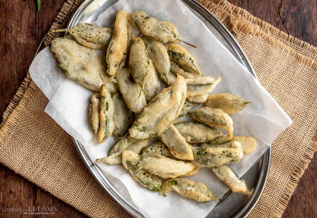 fried sage leaves on a serving platter