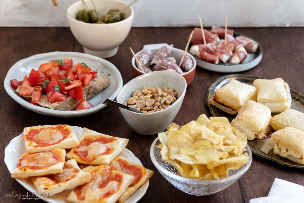 finger foods and snack in bowls and plates on a table