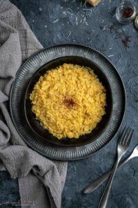 overhead of saffron risotto in a plate