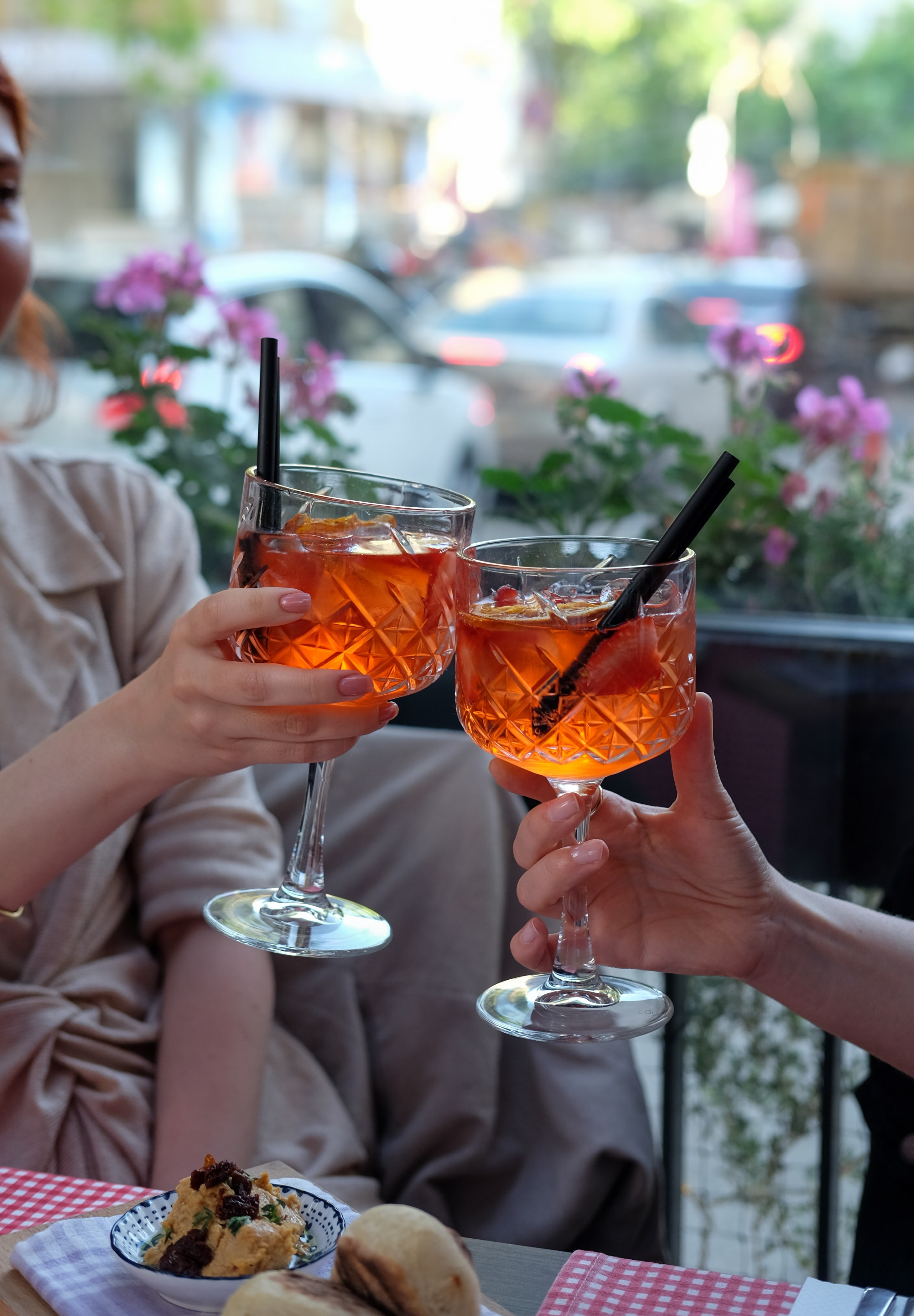 two people cheering at a cafè for aperitivo