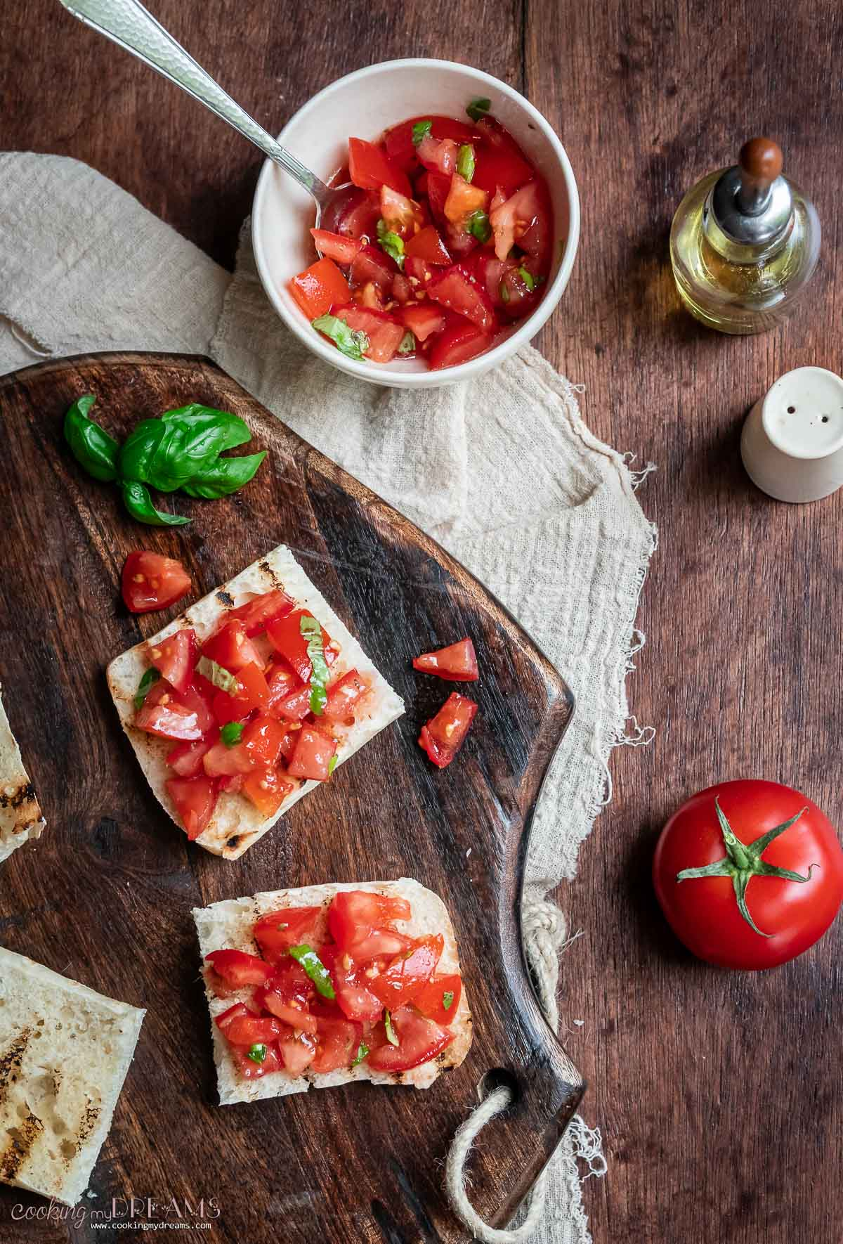 bread and tomatoes on a wooden cutting board